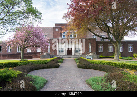 Dorchester, England, UK - May 7, 2016 - The main entrance and gardens of County Hall, offices of Dorset County Council - Stock Photo