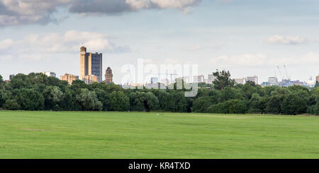 London, England - July 10, 2016: The brutalist Trellick Tower high-rise council housing block and the skyline of - Stock Photo
