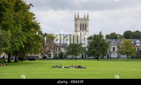 Cambridge, England, UK - August 19, 2017: Students' bicycles are left in a pile in Jesus Green park on a summer - Stock Photo