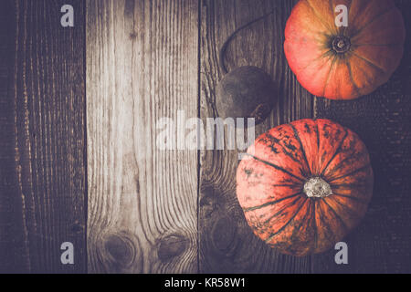 Pumpkins and turnip on the wooden table top view - Stock Photo