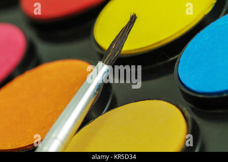 Close up of Water color paints and brush - Stock Photo