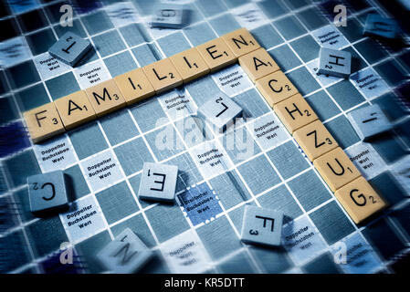 Letters form the words Families and Relief train, Symbolic photo migration and family relief train, Buchstaben bilden - Stock Photo