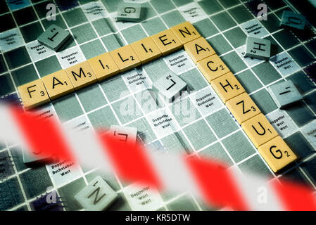 Letters form the words Families and Relief train behind stop tape, symbolic photo put out family relief train, Buchstaben - Stock Photo