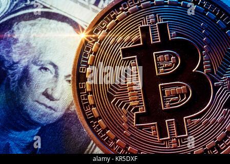 Coin with Bitcoin sign and dollar mark, Münze mit Bitcoin-Zeichen und Dollarnote - Stock Photo