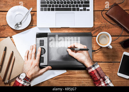 Graphic Designer working with interactive pen display, digital Drawing tablet and Pen on a computer - Stock Photo
