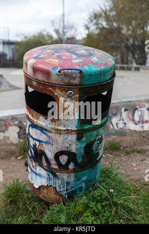 Rusty and graffitied bin in Chesterfield - Stock Photo