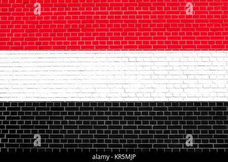 Flag of Yemen on brick wall texture background - Stock Photo