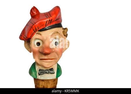 An old cork bottle stopper in the form of a comic caricature of red nosed scotsman. - Stock Photo