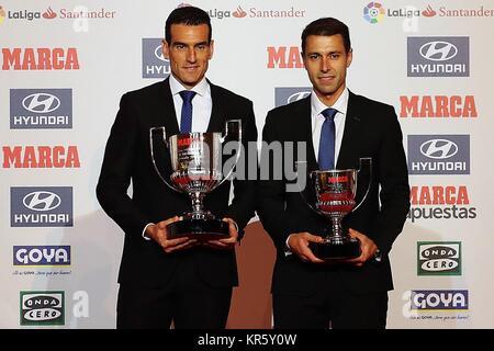 Spanish referees Juan Martinez Munuera (L) and Adrian Cordero Vega (R) pose with the Guruceta Award to the best - Stock Photo