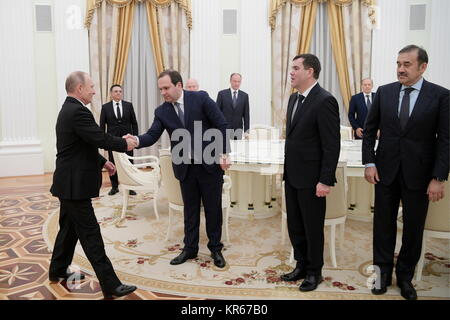MOSCOW, RUSSIA - DECEMBER 19, 2017: Russia's president Vladimir Putin shakes hands with the director of the National - Stock Photo