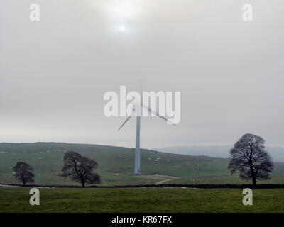 Brassington, Derbyshire. 19th December, 2017. UK Weather wind turbines turning in the cold mist near Brassington, - Stock Photo