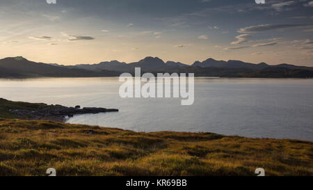 Sunrise casts a glow over the Torridon Hills mountainscape in Wester Ross in the Northwest Highlands of Scotland, - Stock Photo