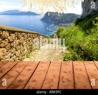The collage from wooden floor and view of Capri island, Italy