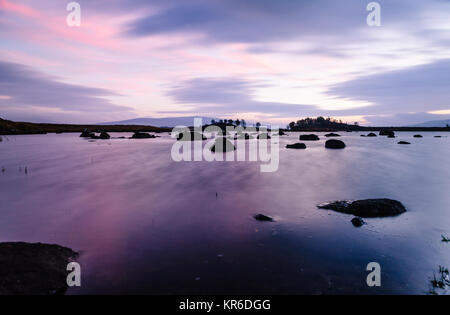 Sunrise approches at Loch Ba on Rannoch Moor in the Highlands of Scotland - Stock Photo