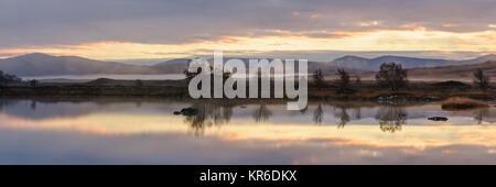 Sunrise over Loch Ba, Rannoch Moor, Highlands of Scotland on a misty autumn morning - Stock Photo