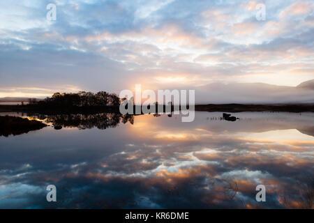 Sunrise over Loch Ba, Rannoch Morr, Highlands of Scotland on a misty autumn morning - Stock Photo
