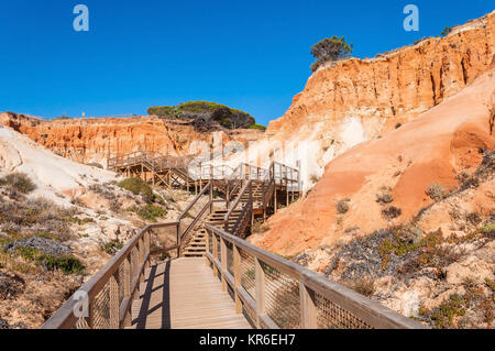 wooden path to falesia beach in portugal - Stock Photo