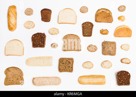 various sliced bread loaves and rolls on white - Stock Photo