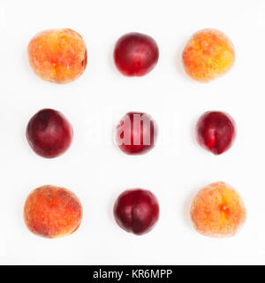ripe nectarines and peaches arranged in square - Stock Photo
