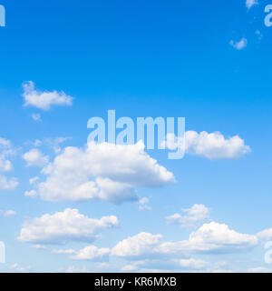 small white clouds in blue sky in sunny day - Stock Photo
