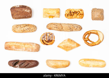 various fresh buns and loaves on white background - Stock Photo