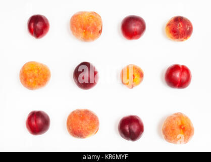 set from ripe nectarines and peaches on white - Stock Photo