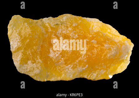Raw, uncut orange calcite (CaCO3) from Mexico isolated on black background - Stock Photo