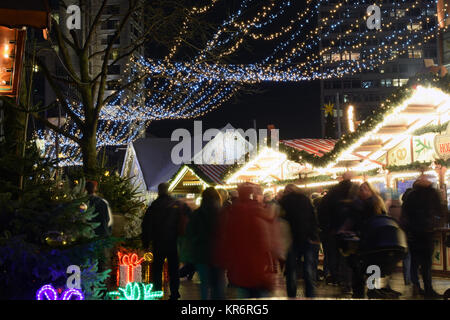 BERLIN GERMANY - December 15 2017: Sales of traditional Christmas sweets on the Christmas market at Breitscheidplatz. - Stock Photo