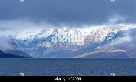 Dramatic Mountains Breaking Through the Coastal Clouds in Auyuittiq National Park on Baffin Island near Pangnirtung, - Stock Photo