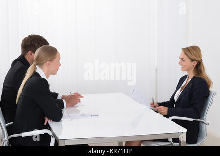 Female Manager Interviewing An Applicant - Stock Photo