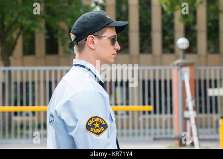 Young Male Security Guard In Uniform - Stock Photo