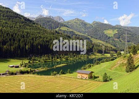 European Alps around village Gerlos in Zillertal valley (Austria). meadows and forests around. - Stock Photo