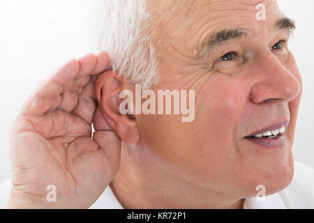 Senior Man Trying To Hear - Stock Photo