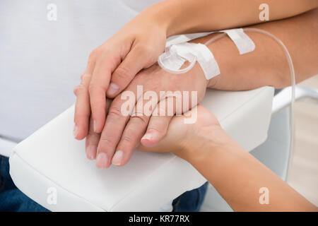 Doctor Holding Patient's Hand - Stock Photo