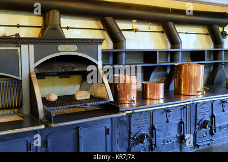 Old Wood Burning Stove in an Antique Kitchen - Stock Photo