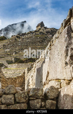 Guardian's house surrounded by clouds in Machu Picchu, Cuzco, Peru - Stock Photo