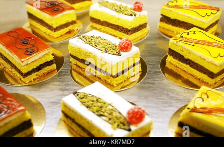 A variety of Italian decorated  pastries or little cakes - Stock Photo