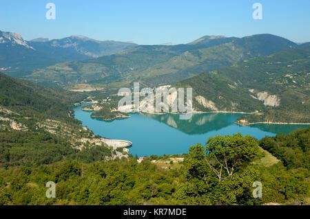 Aerial View over Castillon Lake, Reservoir and Hyroelectric Dam near Castellane, in the Verdon Valley, Alpes-de - Stock Photo