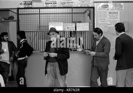 Gambling UK, Bookies betting shop 1970s interior people placing bets 70s England  HOMER SYKES - Stock Photo
