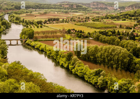 Dordogne river in the vicinity of the medieval village of Domme in the French department of Aquitaine, France, fields - Stock Photo