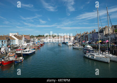 View of Weymouth Harbour in Dorset with Custom House Quay on the left - Stock Photo