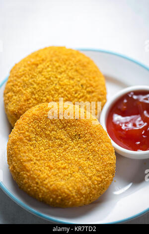 Breaded mozzarella with tomato dip - Stock Photo
