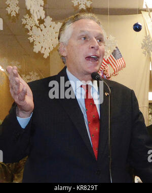 Governor Terry McAulifffe thanks assembled service members for 'putting on the cloth of this country' during remarks - Stock Photo
