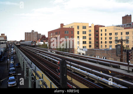 Subway train traveling on elevated tracks - Stock Photo
