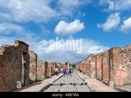 Tourists on Via Stabiana, a street in ancient Pompeii ( Pompei ), Naples, Campania, Italy - Stock Photo
