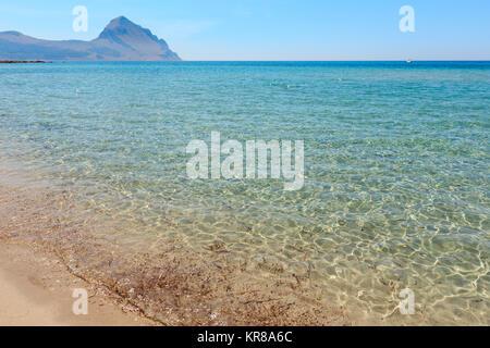 Azure Tyrrhenian sea picturesque bay, Monte Cofano mount and Bue Marino Beach view, Macari, San Vito Lo Capo region, - Stock Photo