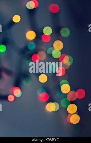 Blurred background with multicolored lights of garland - Stock Photo