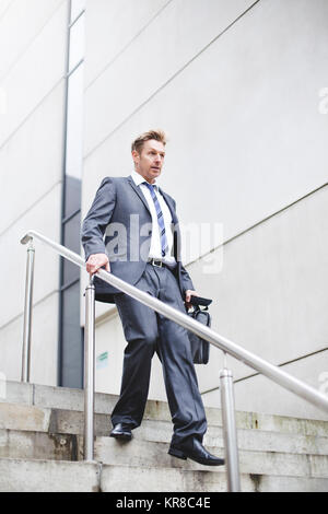 City Businessman Running Late - Stock Photo