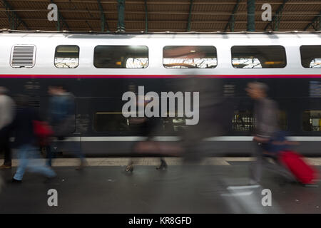 People coming to or leaving train station platform. - Stock Photo