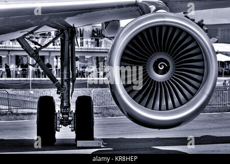 The landing gear and turbofan engine of passenger airliner. Black and white. Toning. - Stock Photo